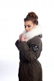 Green down jacket with fox fur on the hood