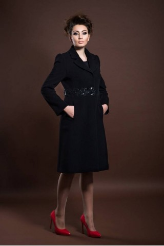 Wool coat with a rever and embedded belt with decoration